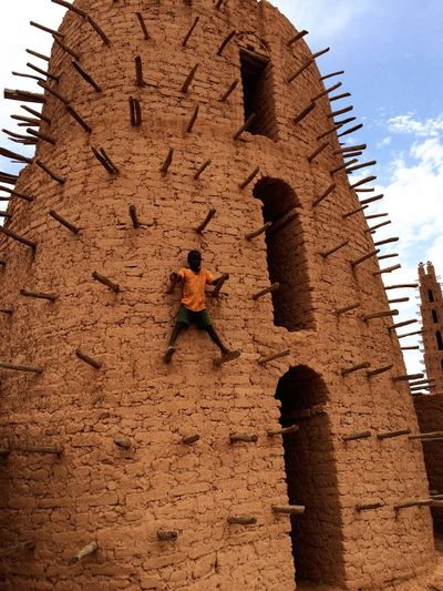 Tower Mosque Sand Brick Wood Burkina Faso Africa Architecture Built Structure Building Exterior Outdoors High Eye4photography  EyeEm Gallery EyeEm Me Around The World Traveling Architecture Children Photography Child Taking Photos Building EyeEm Best Shots The Great Outdoors - 2016 EyeEm Awards The Street Photographer - 2016 EyeEm Awards