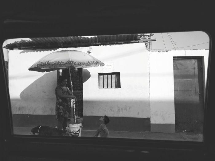 Family matters. VSCO Streetphotography Limaperu Monochrome Full Length Standing Beach Women Umbrella Sunshade Thatched Roof The Art Of Street Photography
