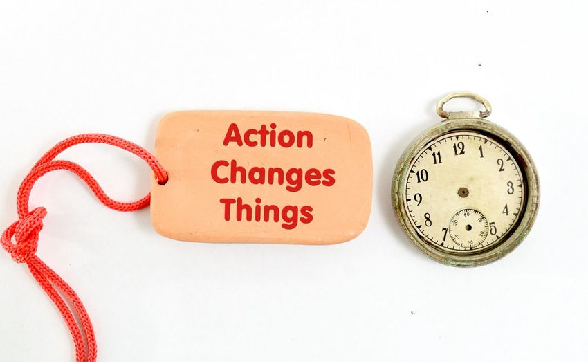 action changes things Motivation Tablet Text Things I Like Action Action Changes Things Clay Clock Clock Face Close-up Day Indoors  Label Minute Hand No People Old Saying Text Time Vintage White Background