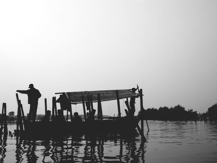 Reflection Lake Water Adult Tradition Outdoors Sky Men Day People Adults Only Fisherman Nature Only Men Full Length Nautical Vessel Rural Scene Clear Sky Young Adult EyeEmNewHere Eyeemphotography Landscape_photography Blackandwhite Photography Black & White Silhouette Photography