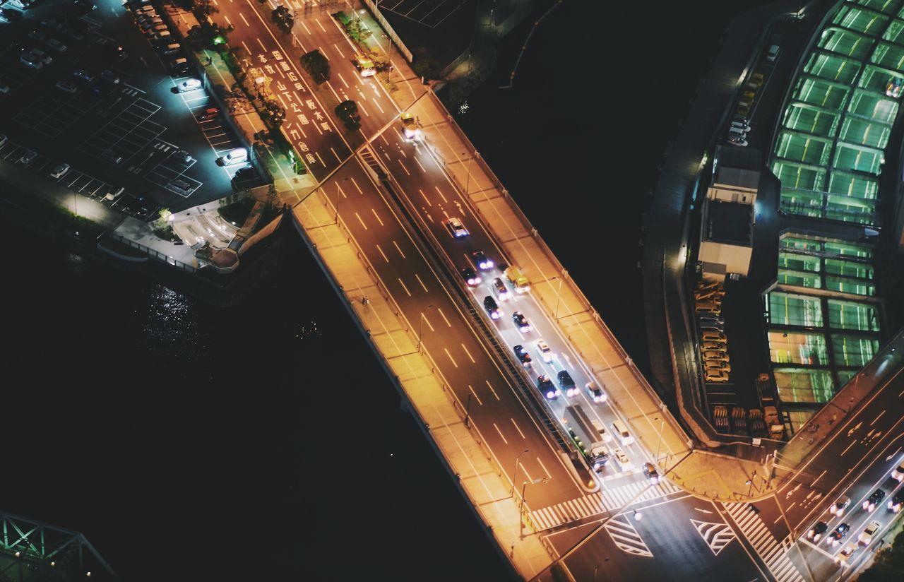 High angle view of vehicles on illuminated bridge at night