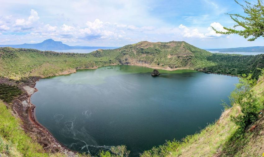 View on the Taal Volcano crater lake Beauty In Nature Caldera Crater Crater Lake Day Exploring Geology Mountain Physical Geography Remote Rock Taal Volcano Tranquility Volcano Water
