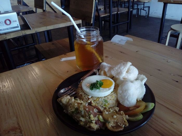 Food And Drink Table Freshness Food Egg Yolk Ready-to-eat Healthy Eating No People Drink Breakfast Indoors  Fried Egg Close-up Day Nasi Goreng Gila Fried Rice Sweet Tea Es Teh Manis Indoors  Plate Drinking Glass Serving Size High Angle View