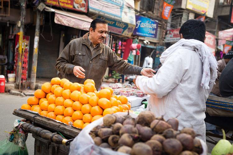 Full length of man at market stall