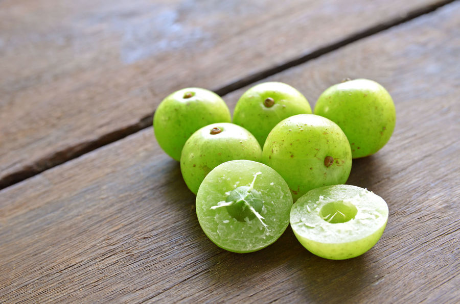 Indian gooseberry It is used in herbal medicine. Green Healthcare India Medicine Nature Ayurveda Berry Climate Close-up Culture Ethnic Food Food And Drink Freshness Fruit Gooseberry Green Color Healthy Eating Herbal No People Pill Small Traditional Tropical Vitamin