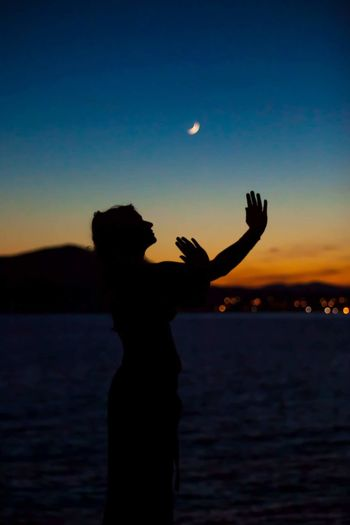 Silhouette Sunset Moon Nature Sky Water Blue Summer Beauty In Nature Beach Space Scenics Woman One Woman Only Goddess Dancing Conciousness  Colours Colour Of Life Colours Of Nature Colours Of Life Colourful Sky Outdoors People Be. Ready. A New Beginning This Is Strength