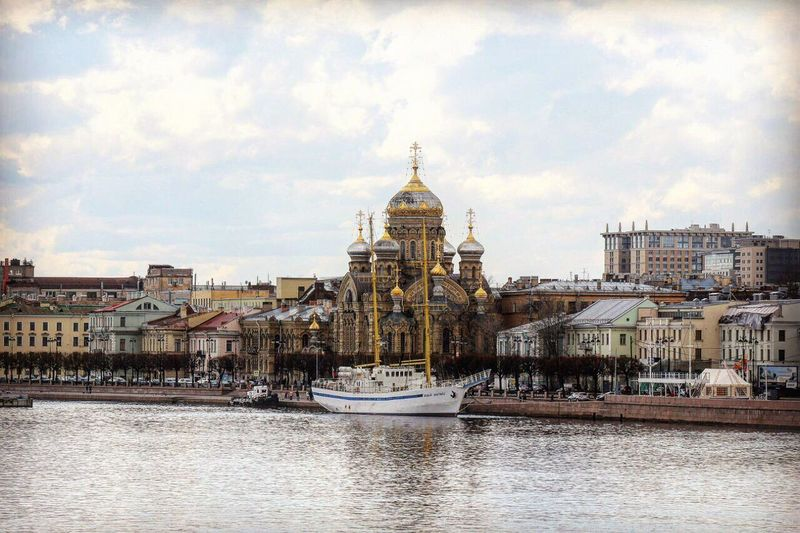 Church Of The Assumption Of The Blessed Virgin Mary By River Against Sky