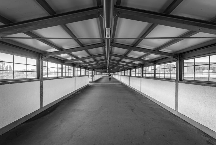 View of empty covered walkway in building