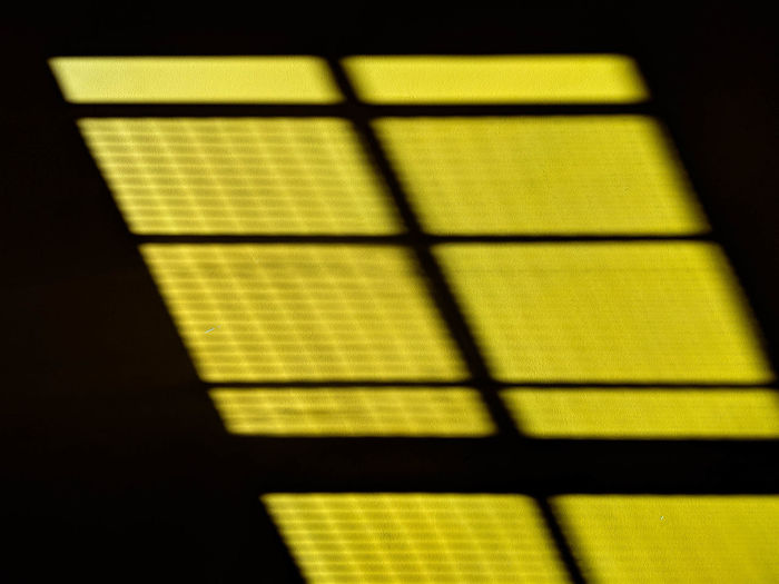 close-up of yellow shadow on window Architecture Black Background Built Structure Close-up Dark Day Design Focus On Shadow Geometric Shape Grid Indoors  Nature No People Pattern Selective Focus Shadow Shape Sunlight Wall - Building Feature Window Yellow