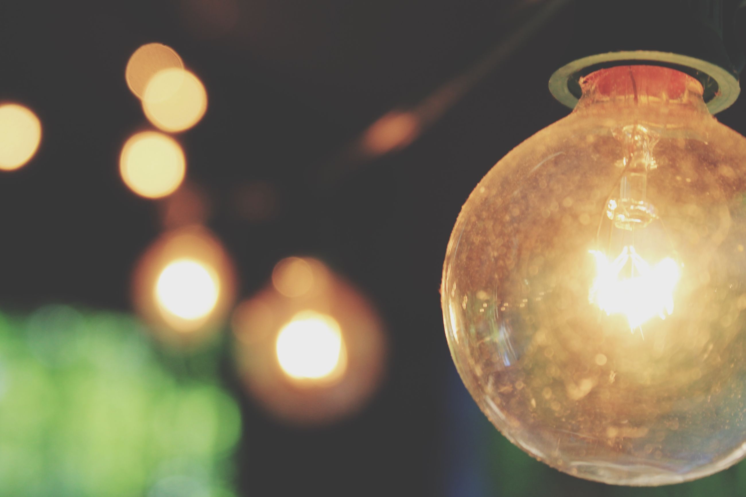 illuminated, lighting equipment, sphere, indoors, light bulb, close-up, decoration, night, hanging, electricity, focus on foreground, glowing, electric light, glass - material, transparent, ceiling, light - natural phenomenon, low angle view, electric lamp, no people