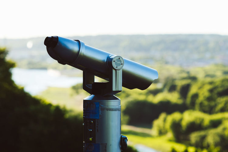View to the city Big Brother - Orwellian Concept Binoculars Blue Clear Sky Close-up Coin Operated Coin-operated Binoculars Day Field Focus On Foreground Hand-held Telescope Nature No People Outdoors Scenics Sky Surveillance Technology Telescope Watching