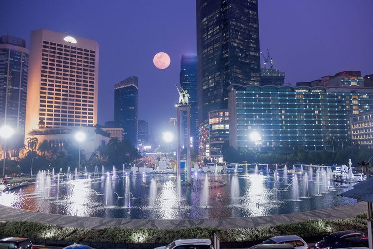 Architecture Building Building Exterior Built Structure City City Life Cityscape Financial District  Illuminated Modern Moonrise Nature Night No People Office Office Building Exterior Outdoors Sky Skyscraper Street Supermoon Tall - High Tower Transportation