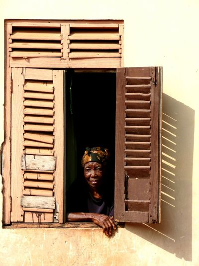 Beautiful people of Africa House Window Openwindow Beautiful Woman Woman Old Woman Wooden Window Shutters Color Portrait Day Ghana Tribe EyeEmNewHere Portrait EyeEm Portraits Portret Photo