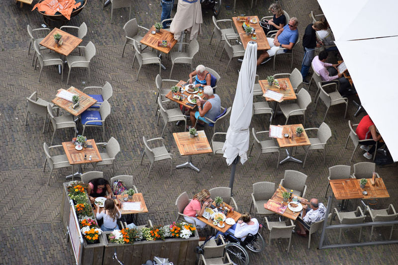 Delft people from above Weekend Adult Business Cafe Chair Crowd Day Eating Enjoying Life Europe Food Food And Drink FreeTime Group Of People High Angle View Large Group Of People Leisure Activity Lifestyles Men Real People Seat Sitting Table Tables Women