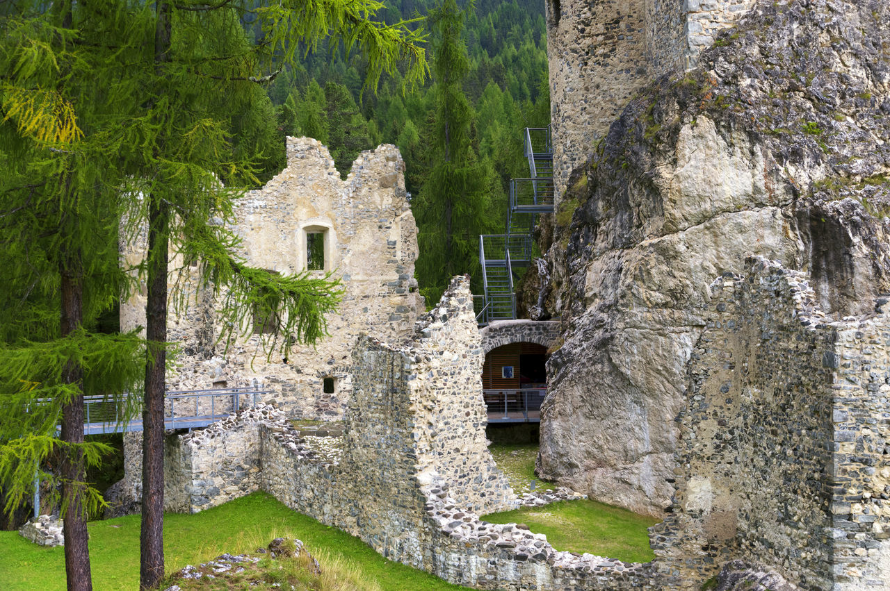 architecture, history, stone material, castle, built structure, building exterior, rock - object, travel destinations, no people, cliff, tree, old ruin, outdoors, day, ancient civilization, rock face, nature