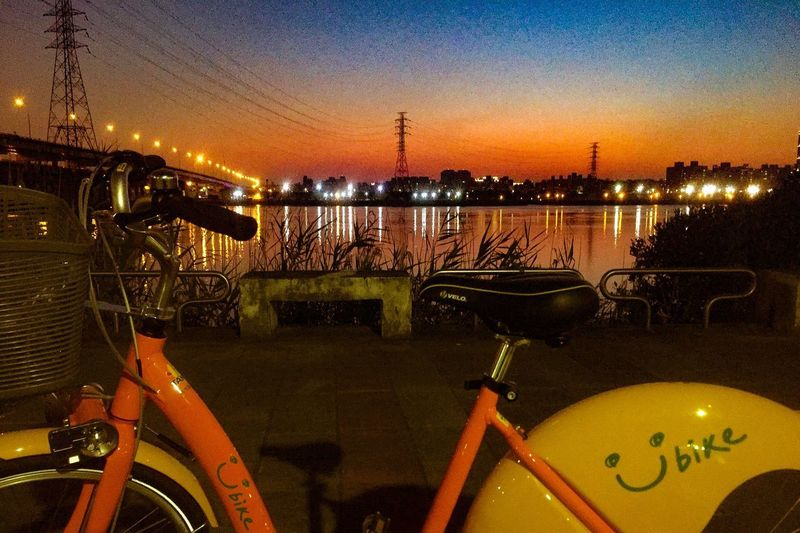 The city I live is an interesting and handy place. Enjoy the public bicycles of world famous GIANT brand everywhere. I think the bike company should buy my picture because this view was so amazing. Transportation Mode Of Transport Bicycle Illuminated Night Sunset Sky City Outdoors Nature EyeEmNewHere Welcome To Black Ubike Emotional Photography Travel Photography Streetphotography Catch The Moment Tranquility Beauty In Nature Multi Colored Cycling Street Photography Taipei,Taiwan Taipei City Senery Been There. Done That. Colour Your Horizn Mobility In Mega Cities