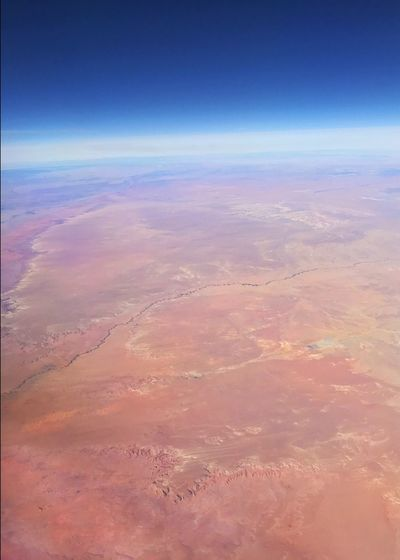 Desert color. Vertical Geology Arid Landscape Desert Colors Desert Curvature Of The Earth Nature Beauty In Nature Scenics Tranquility Tranquil Scene Outdoors Aerial View No People Landscape The Natural World View Into Land Cloud - Sky