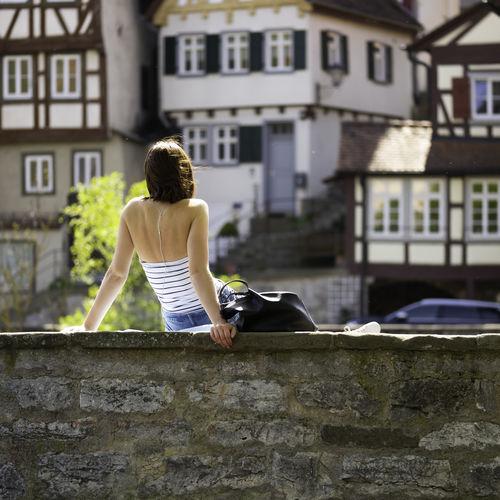 Rear view of woman walking outside building