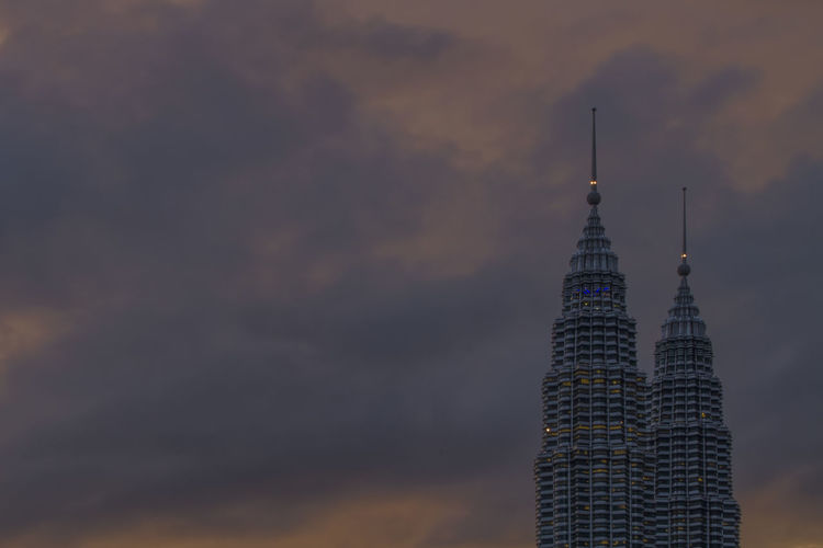 A sun rise scene over the two towers in Kuala Lumpur, capital city of Malaysia Malaysia Truly Asia Two Towers Architecture Building Exterior Built Structure City Malaysia Malaysia Scenery Modern Nature Night No People Outdoors Sky Skyscraper Sunrise_sunsets_aroundworld Tall - High Tourism Tower Travel Destinations