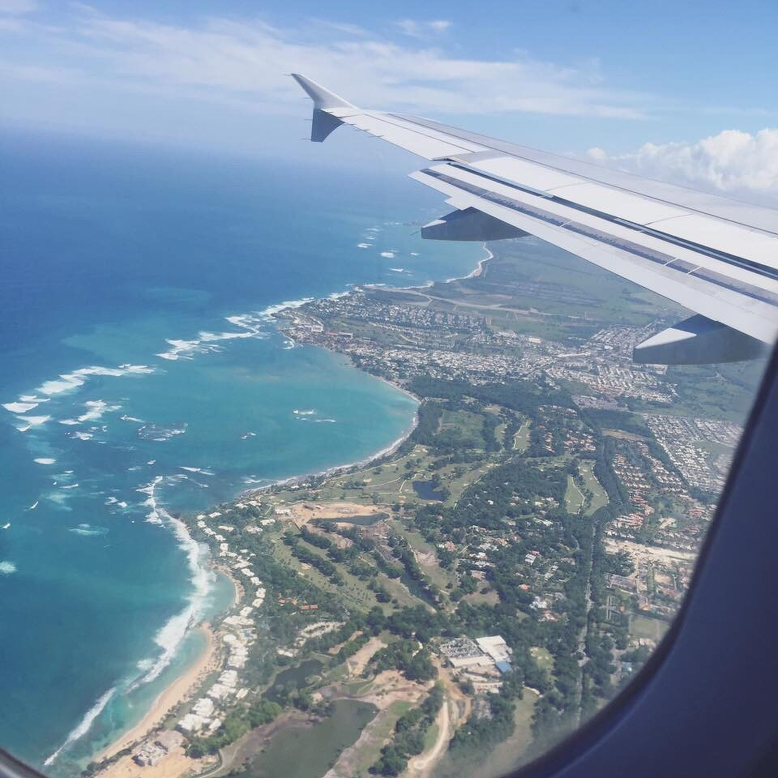 airplane, transportation, aerial view, aircraft wing, air vehicle, flying, mode of transport, sea, part of, cropped, travel, mid-air, sky, water, scenics, journey, on the move, landscape, airplane wing, nature