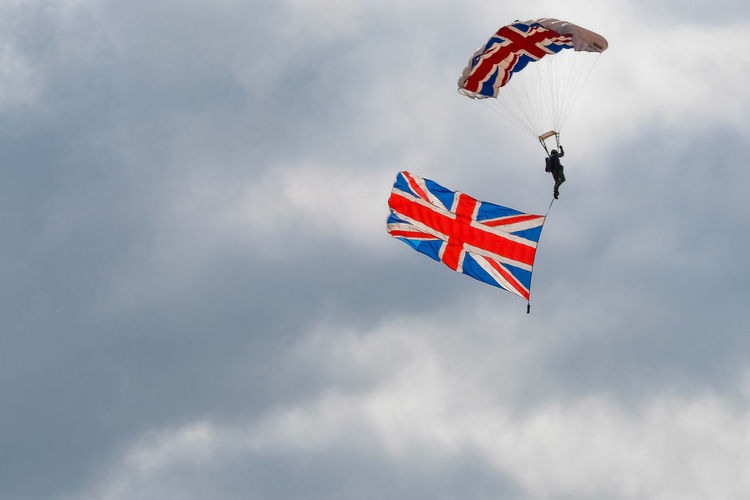 Member of the Tigers Parachute Display Team comes in to land at Clacton Airshow, with Union Jack. Clacton-on-Sea Essex Essex Sunshine Coast Cloud - Sky Day Flag Flying Low Angle View Mid-air Multi Colored Nature No People Outdoors Parachute Pride Sky Union Jack Wind