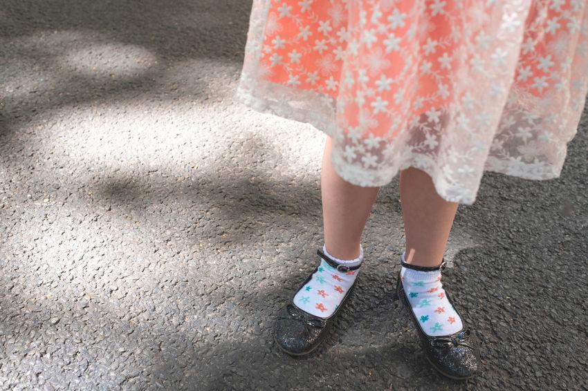 Dress Body Part Child Childhood City Day Fashion Females Festive Girls Human Body Part Human Foot Human Leg Human Limb Lifestyles Limb Low Section Offspring One Person Orange Color Outdoors Shoe Standing Street Women