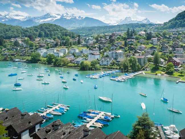 Spiez Architecture Blue Boat Built Structure City Cityscape Day Harbor Mountain Mountain Range Nature No People Outdoors Residential Building Residential District Residential Structure Scenics Sky Spiez Switzerland Town TOWNSCAPE Tranquil Scene Tranquility Water