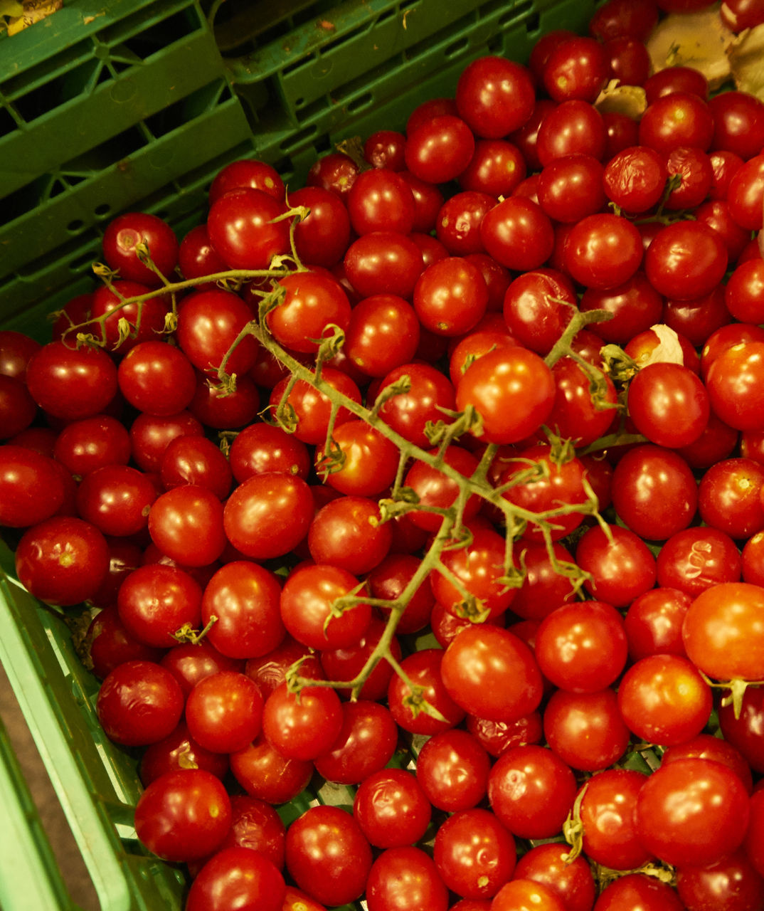 High Angle View Of Tomatoes In Crate At Market
