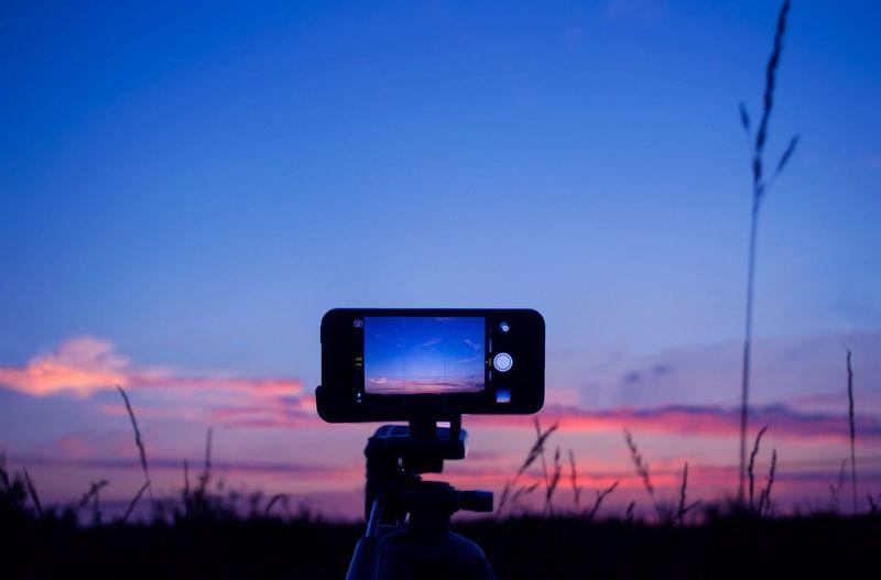 Camera on tripod at sunset