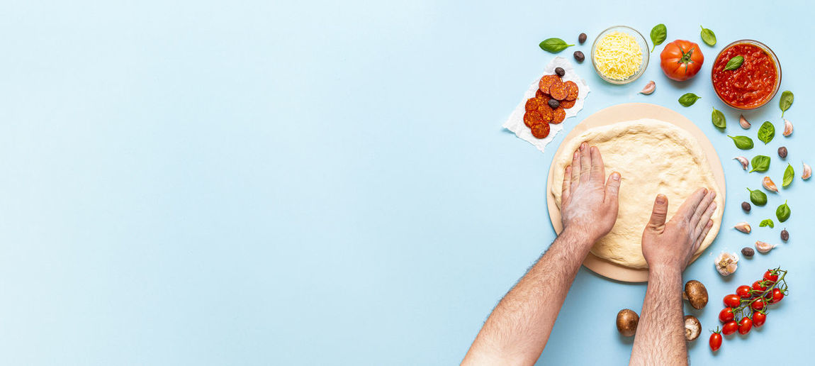 High angle view of hand holding fruit against white background
