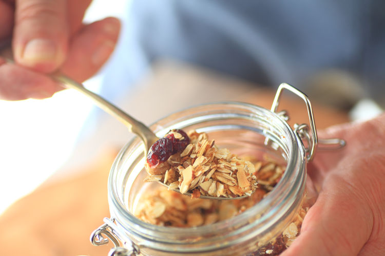 Close-up of person holding oats jar