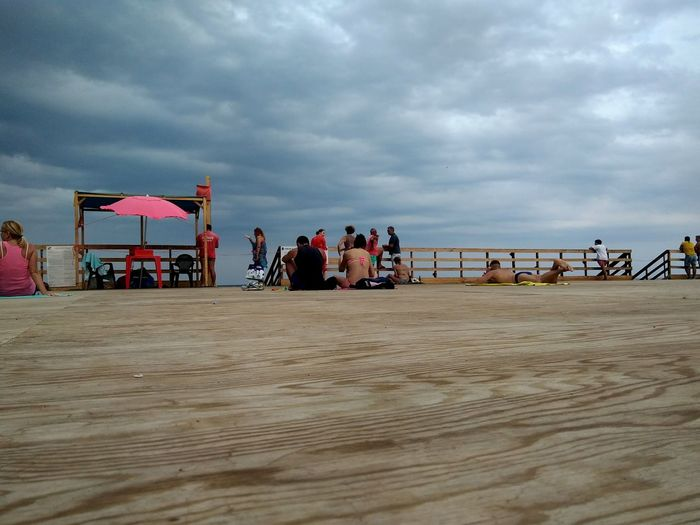 Beach Sea Cloud - Sky People Horizon Over Water Waterfront Water Reflections Clouds And Sky Storm Cloud Stormy Weather San Giovanni Li Cuti EyeEm Selects EyeEmBestPics EyeEm Nature Lover EyeEm Gallery The Week On EyeEm Mix Yourself A Good Time Cloudy EyeEmNewHere