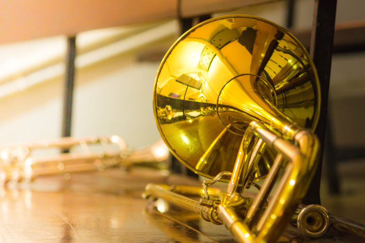 Arts Culture And Entertainment Brass Instruments Close-up Day Gold Colored Illuminated Indoors  Musical Instrument Musical Instrument String No People Reflection Shiny Yellow