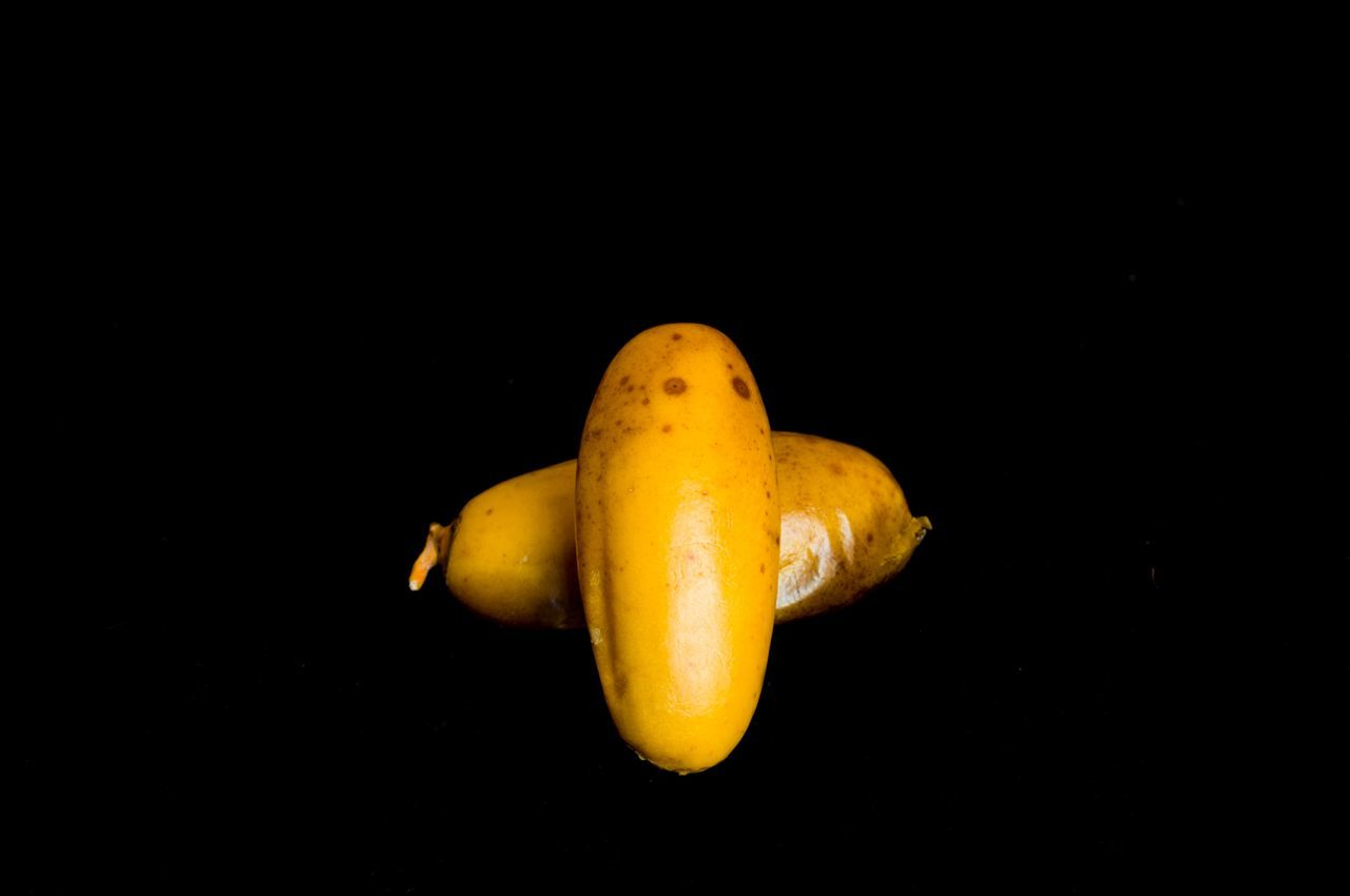 black background, studio shot, fruit, food and drink, copy space, healthy eating, yellow, food, no people, freshness, close-up, day
