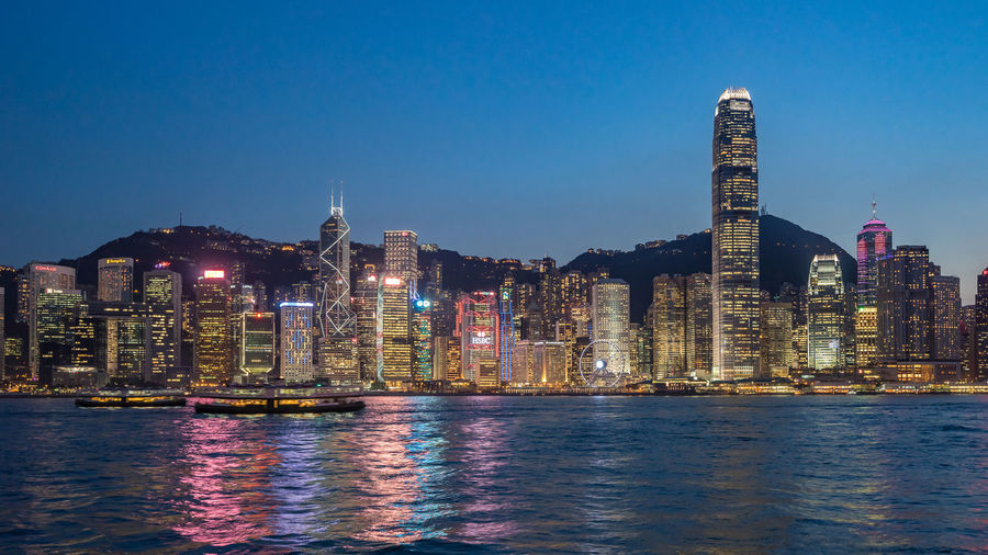 Two International Finance Centre At Victoria Harbour In City During Night