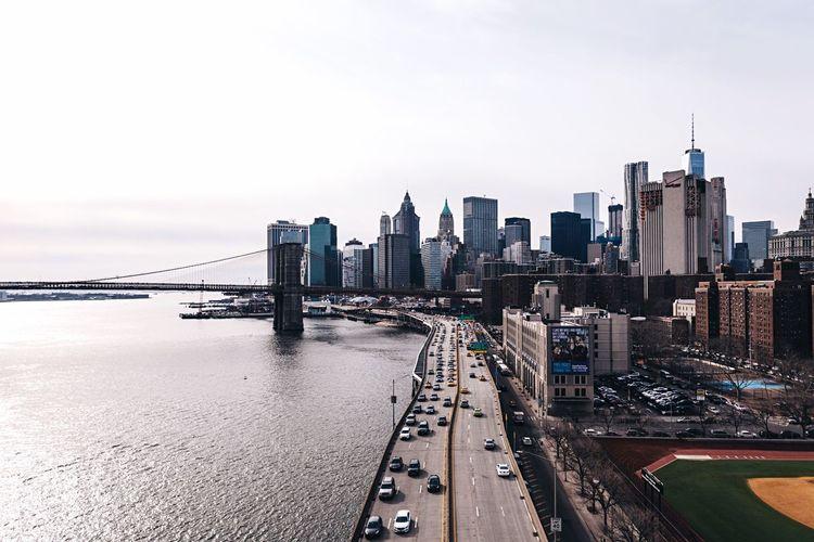 Urban Skyline And Brooklyn Bridge Against Sky