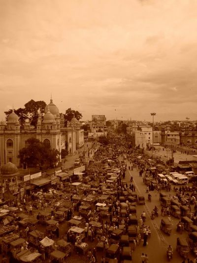 My beautiful city. Architecture Building Exterior Sepia_collection Sepia Toned City Life Cityscape Clouds And Sky Crowded Crowded Street Street Market Eyem Best Shots Eyemphotography High Angle High Angle View Historical City Hyderabad,India Market Stall Sepia Sky Streetphotography Travel Travel Destinations India Sepia Photography Gradient