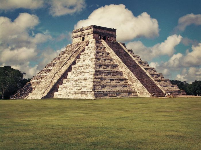 Chitza Nitza, Mexico Mayan Ruins Mexico Ancient Ancient Civilization Archaeology Architecture Building Exterior Built Structure Cloud - Sky Day Grass History Low Angle View Mayanculture Nature No People Old Ruin Outdoors Pyramid Sky Temple The Past Tourism Travel Destinations Vacations