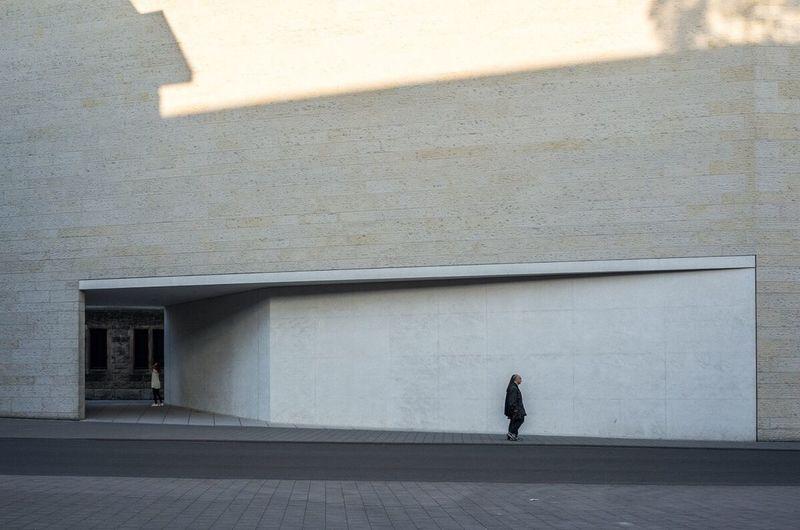Full length of man walking on wall