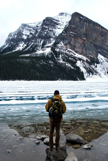 Travel One Person One Man Only Nature Outdoors Beauty In Nature People Water Day Sky Mountains Lake Louise,Alberta Lake Louise  Reflection Snow Spring Melting Snow Melting Ice Hiking Trail Adventure Explore
