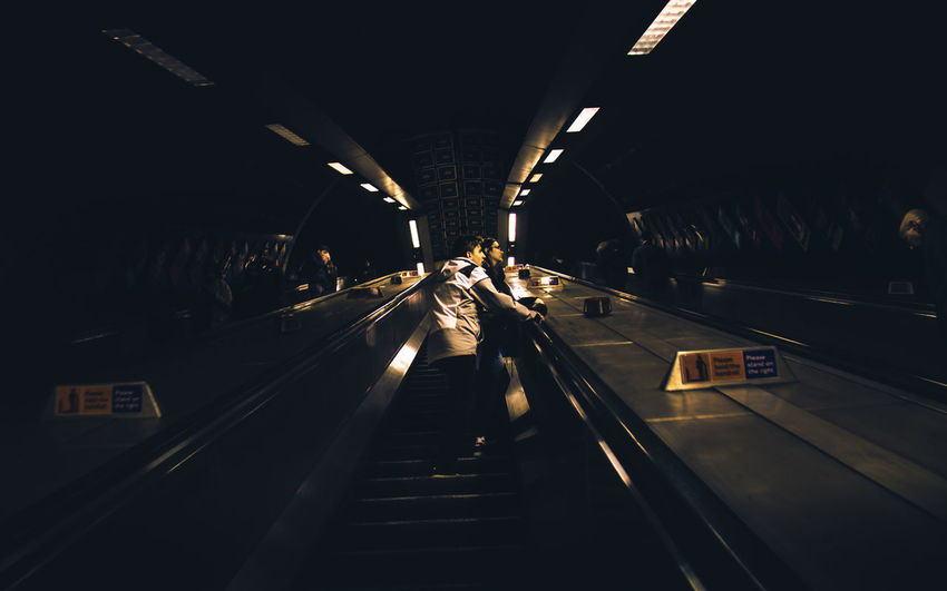 Travelling on the London Underground... going up the escalators... people watching :-) Escalators Forward Tourist Traveling Travelling Architecture Built Structure City Day Escalator Forwards Illuminated Indoors  Lighting Equipment Modern Real People The Way Forward Transportation Tunnel Underground Up Visitors