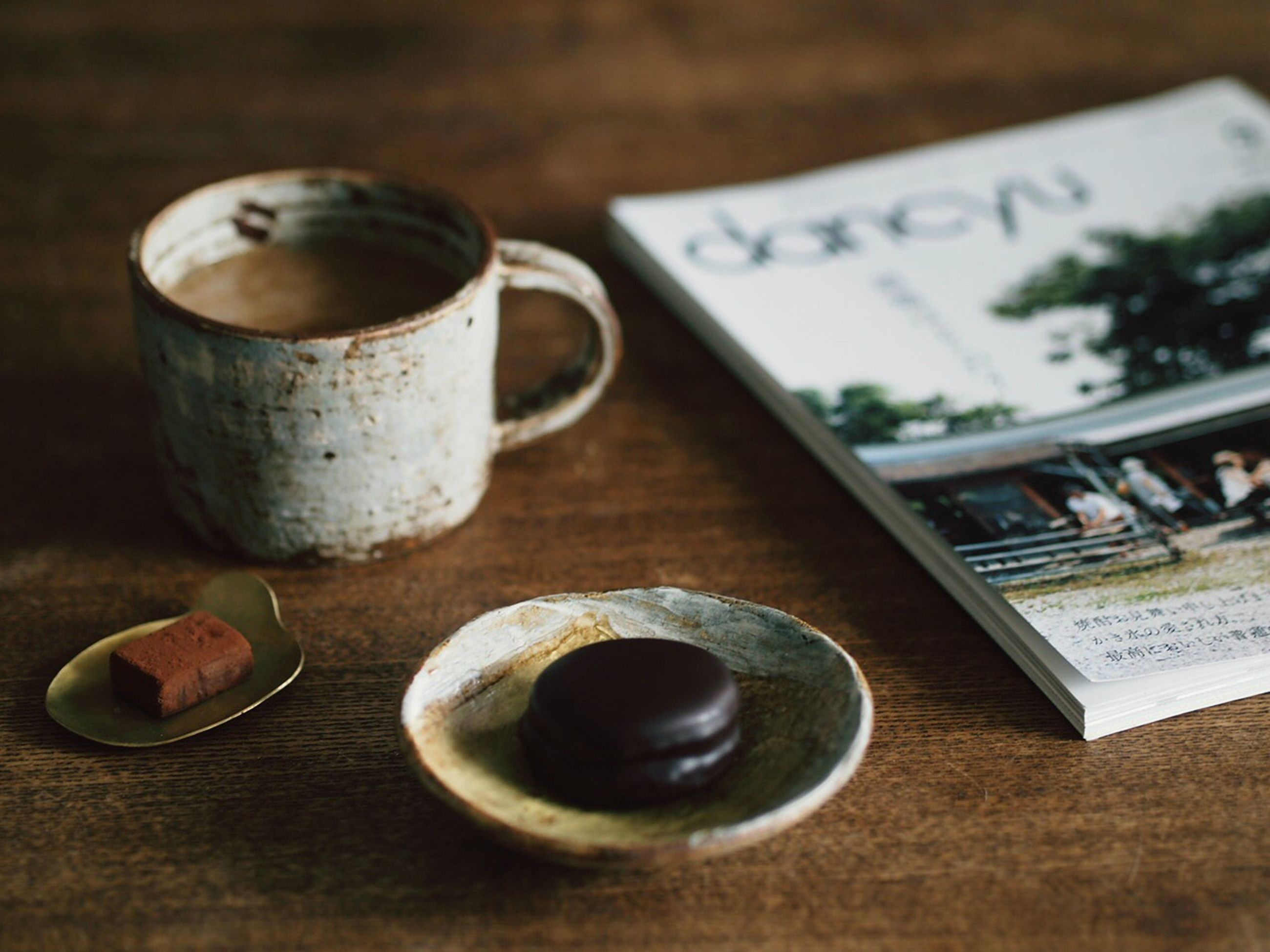 indoors, still life, table, close-up, metal, wood - material, old, selective focus, metallic, no people, food and drink, rusty, focus on foreground, variation, high angle view, wooden, container, communication, antique, equipment