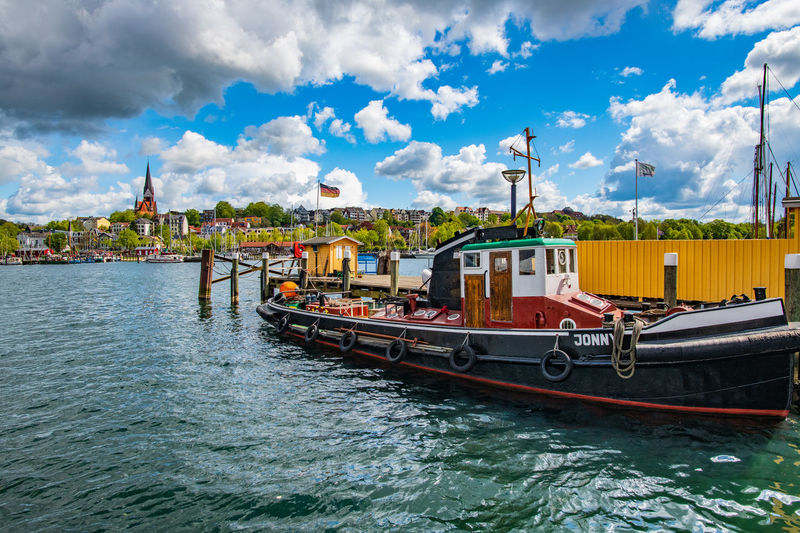 Flower Cloud - Sky Spring Countryside Village Life Village Germany Nautical Vessel Water Transportation Sky Mode Of Transportation Waterfront Nature Architecture Day Built Structure Building Exterior River No People Travel Outdoors Moored Building Passenger Craft Sailboat Harbor Harbor View Flag