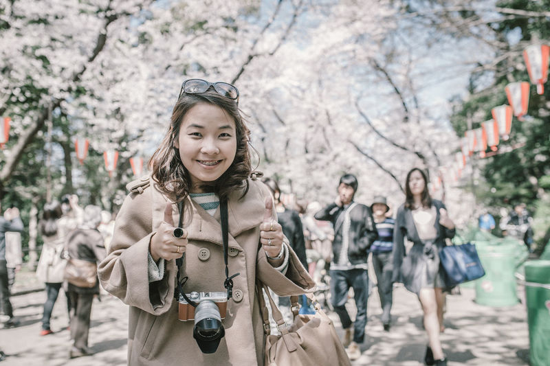 Front View Focus On Foreground City Smiling Day Happiness Tree Portrait Standing One Person Incidental People Women Looking At Camera Lifestyles Young Adult Nature Young Women Leisure Activity Emotion Warm Clothing Outdoors Trench Coat Springtime Fujifilm X-A2