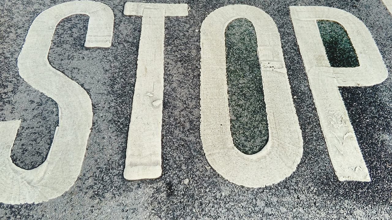 asphalt, communication, no people, outdoors, day, road, close-up, orthographic symbol