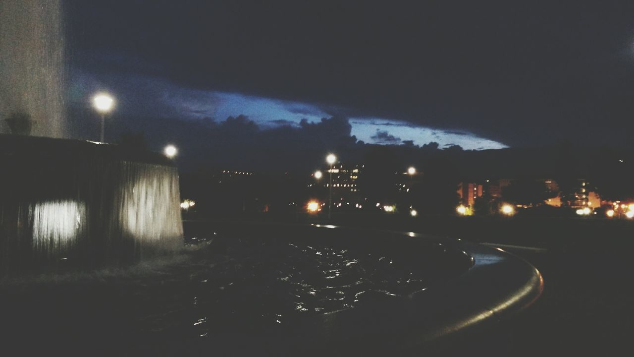 Close-Up Of Fountain In Illuminated City At Night