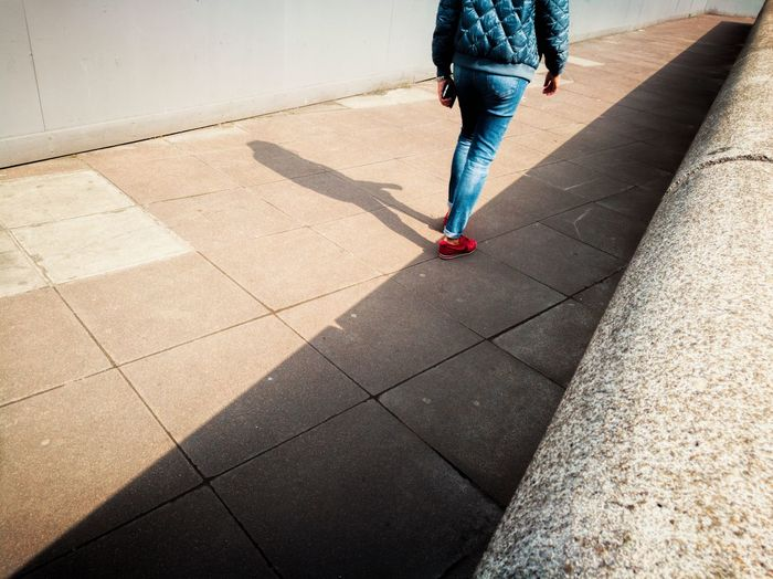 Shadow Human Body Part Human Leg One Person Huawei P9 Photos Tranquility Lonliness Walking Alone... Simetry Sunlight City Life Normal Life Woman Walking On The Street Shade Person Person Wearing Jeans Sunny Day Coat Jeans Red Trainers The Street Photographer - 2017 EyeEm Awards