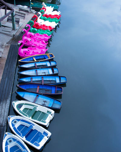 High angle view of multi colored boats moored in river