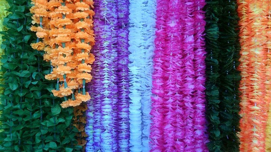 Full Frame Shot Of Artificial Floral Garlands