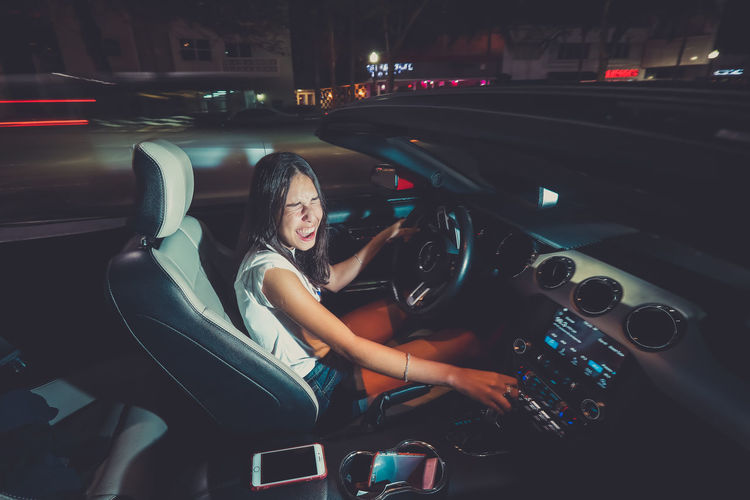 Girl Car Speed Transportation Motor Vehicle Mode Of Transportation Illuminated Night One Person Real People Land Vehicle Young Women Lifestyles Women City Young Adult Travel Leisure Activity Adult Architecture Vehicle Interior Nightlife Outdoors Hairstyle Beautiful Woman